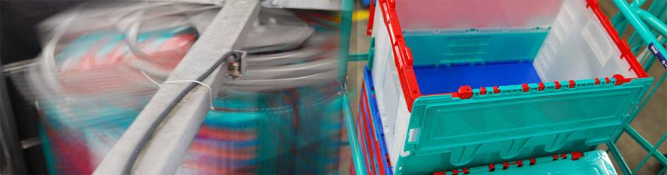 カゴ台車一体型 プラコン洗浄脱水機